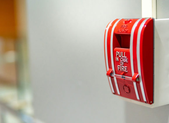 Picture of a fire alarm that denotes fire safety ratings of our cloud ceilings.